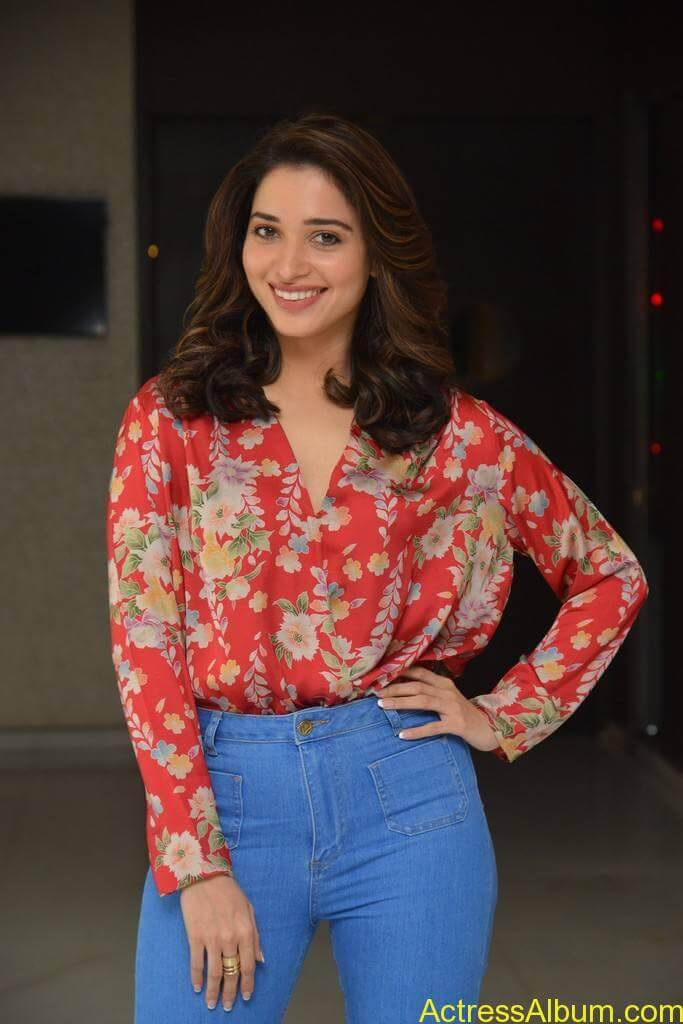 Tamanna in Orange Top and Blue Jeans