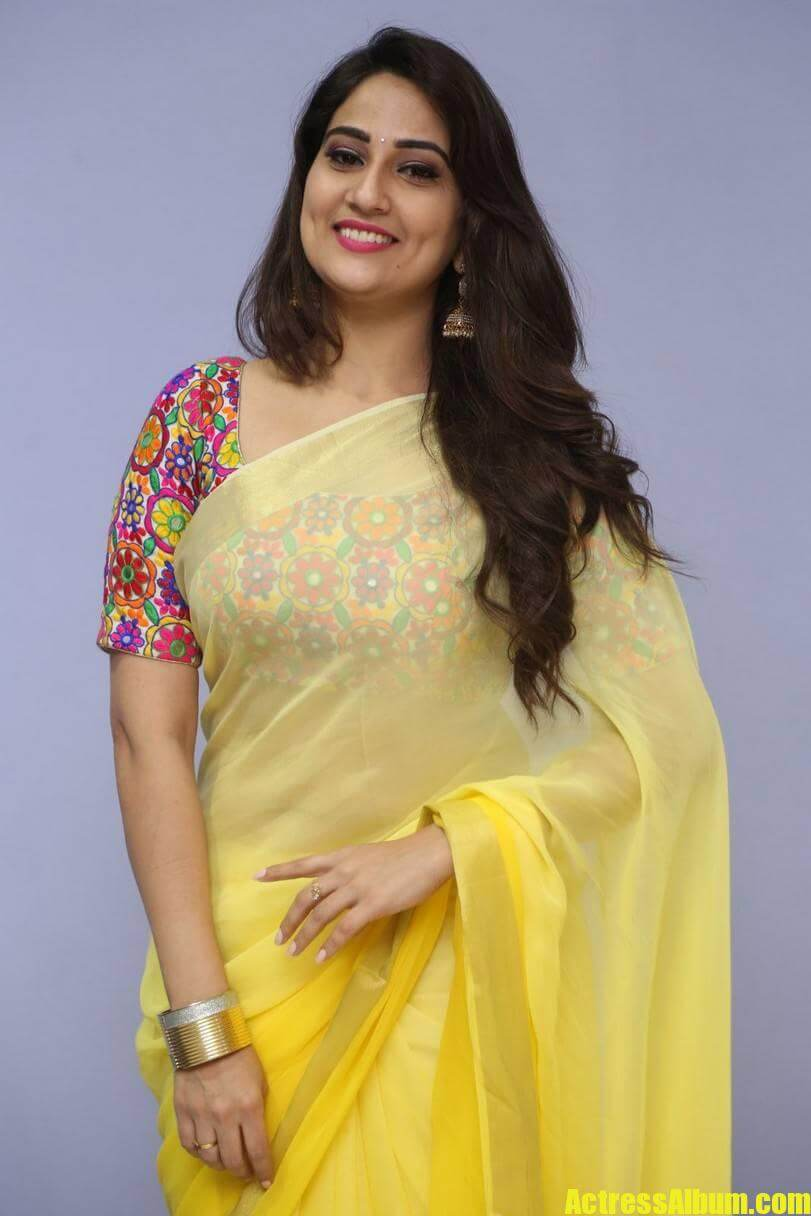 tv-anchor-manjusha-hot-stills-in-yellow-saree-2