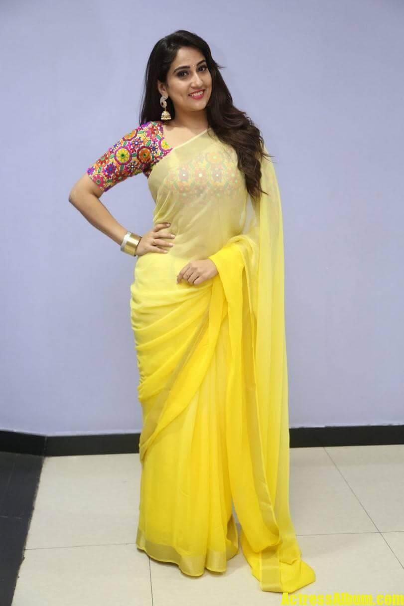 tv-anchor-manjusha-hot-stills-in-yellow-saree-4