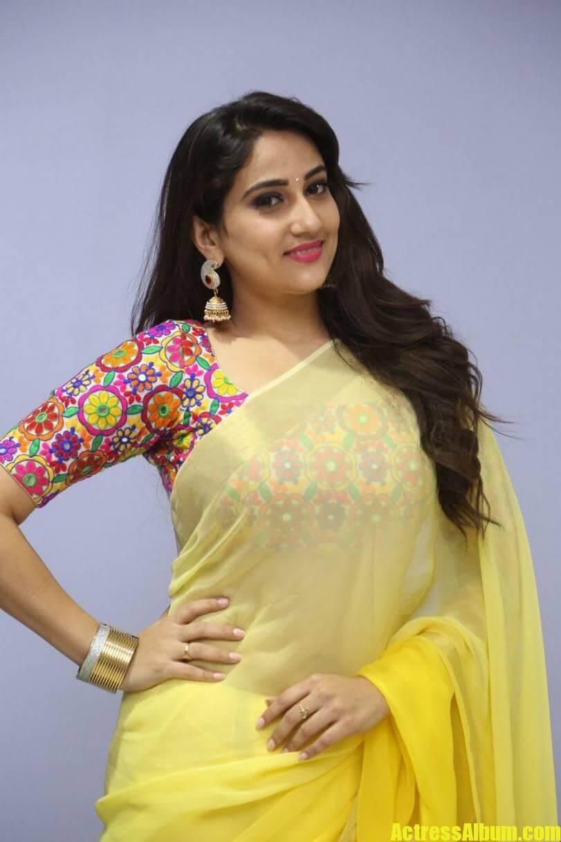 tv-anchor-manjusha-hot-stills-in-yellow-saree-5