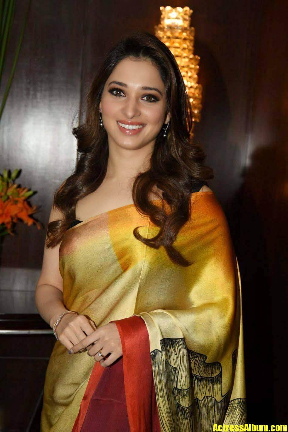 Tamanna Films: Tamanna Stills In Yellow Saree At Lakme Fashion Week