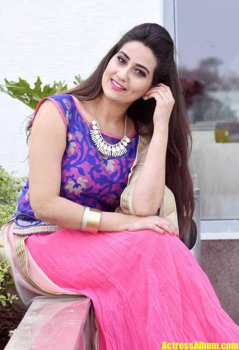 Manjusha In Violet Dress