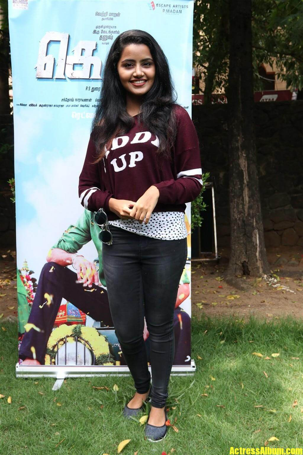 bubbly girl anupama parameshwaran in maroon dress