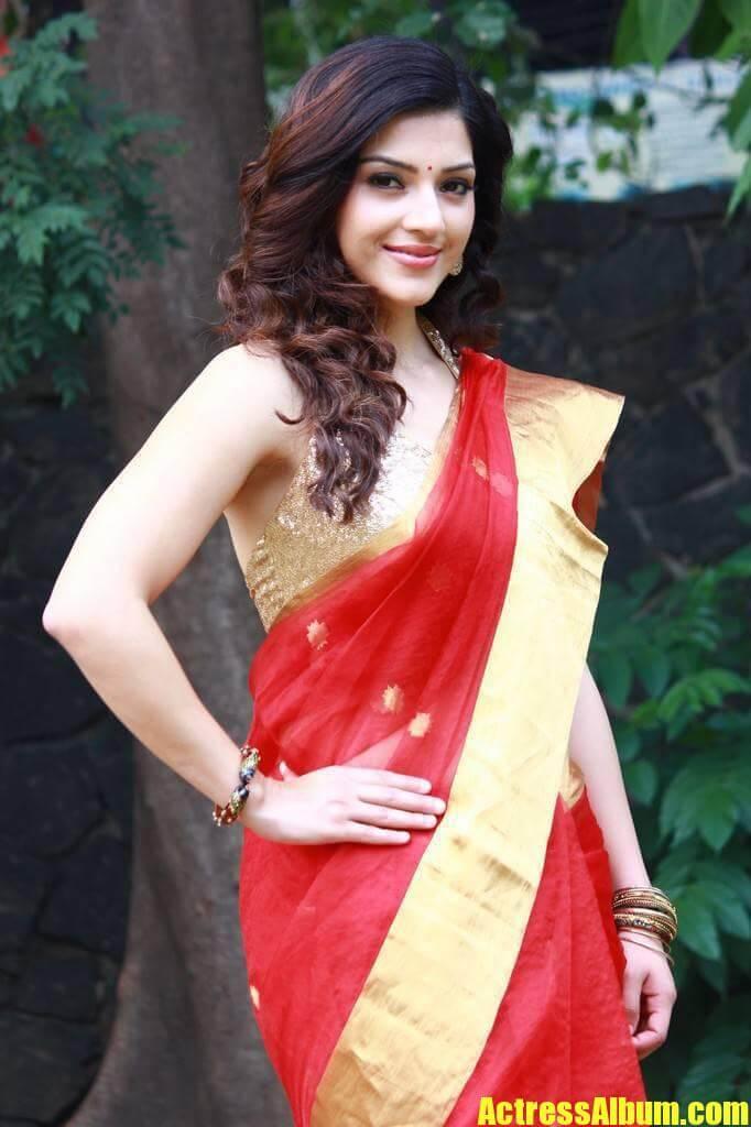 Actress Mehreen Kaur Stills In Traditional Red Saree