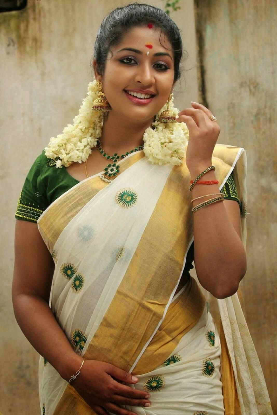 Malayalam Actress Navya Nair Smiling Stills In White Saree -2981