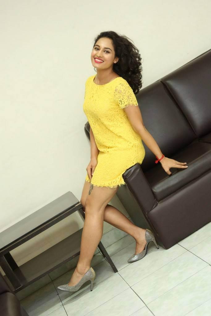 Pooja Ramachandran Long Legs Stills In Mini Yellow Dress