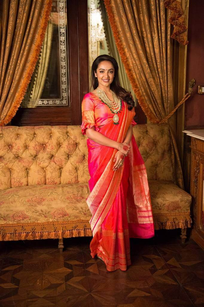 Telugu Actress Tejaswi Madivada Stills In Orange Saree