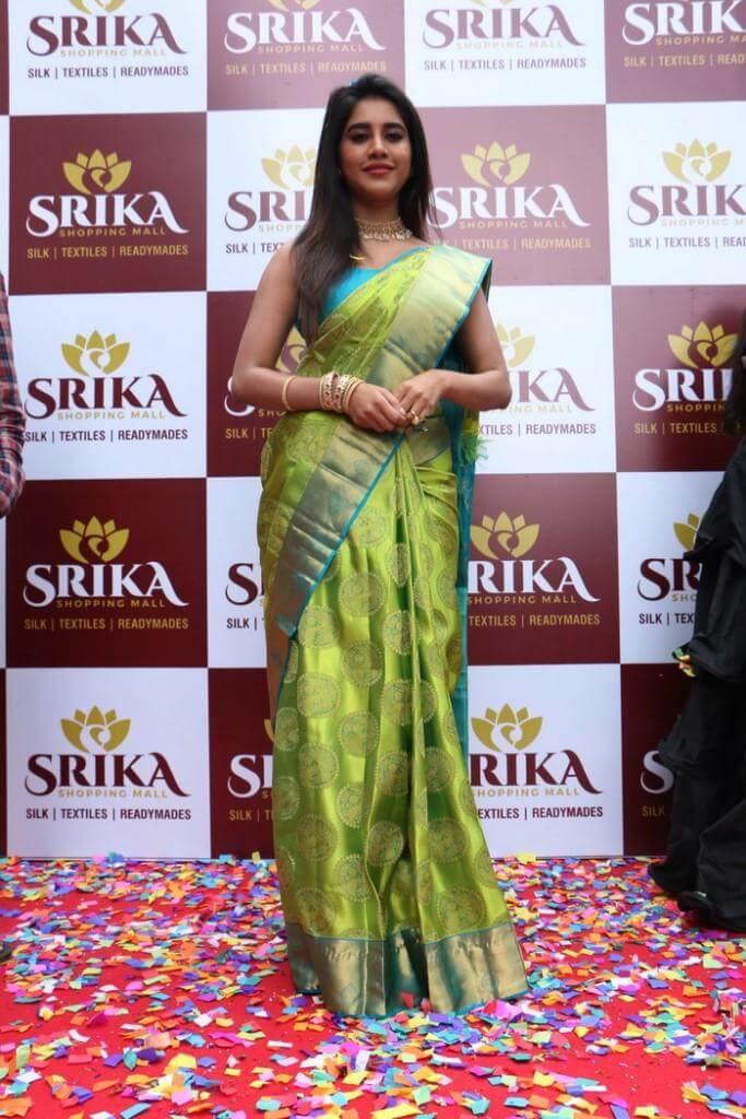 Nabha Natesh Pics In Green Saree At Srika Shopping Mall Launch