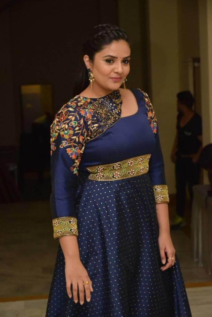 Srimukhi Photos In Violet Dress