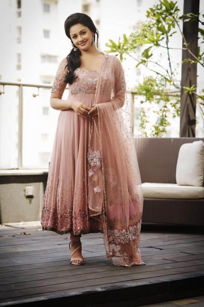 Spicy Stills Of Pooja Kumar In Long Dress