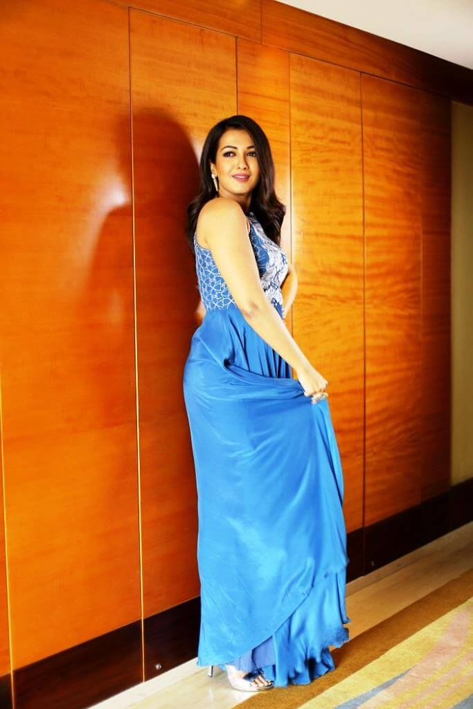 Catherine Tresa In Blue Dress At Hotel Lounge