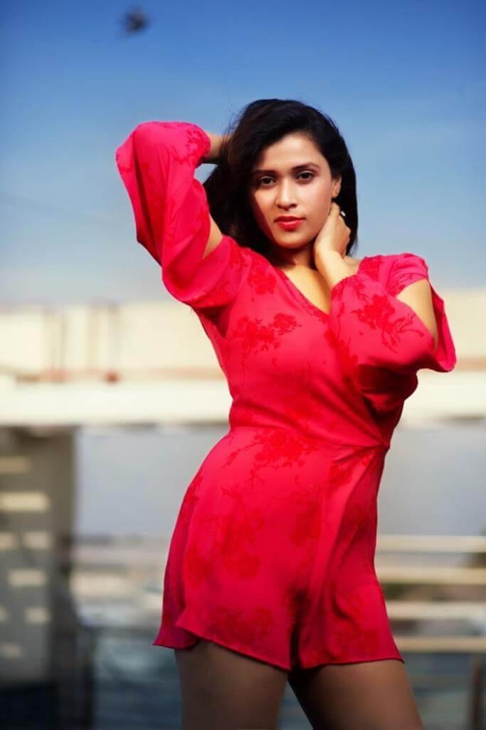 Mannara Chopra Hot Images In Red Skirt