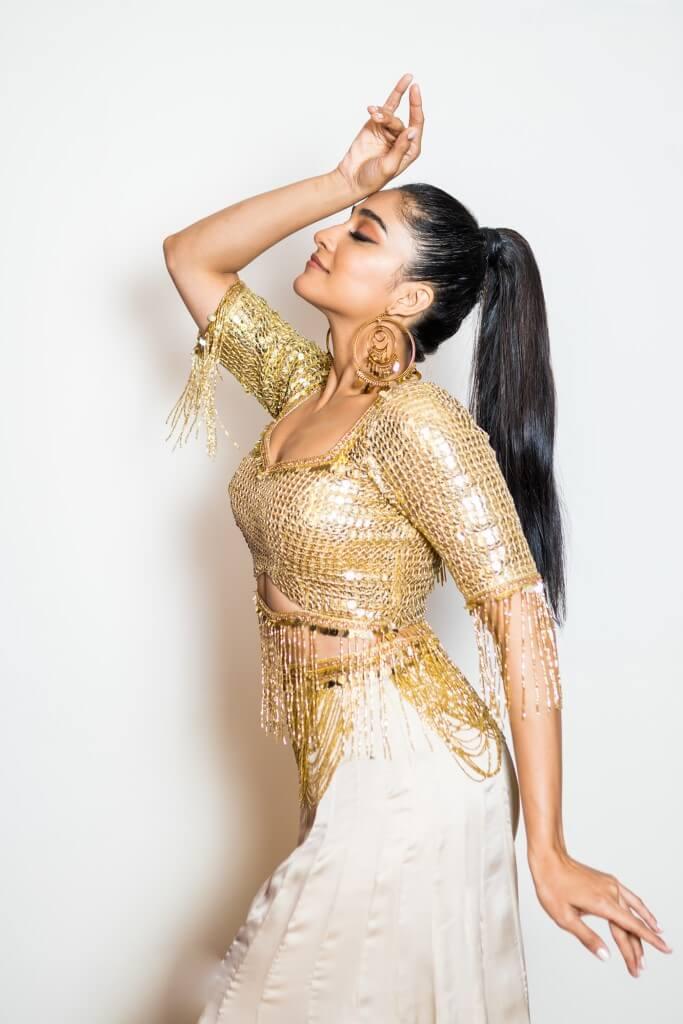 Regina Cassandra In Gold Dress