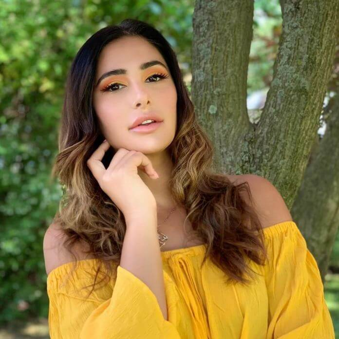Nargis Fakhri HD Pictures In Yellow Skirt