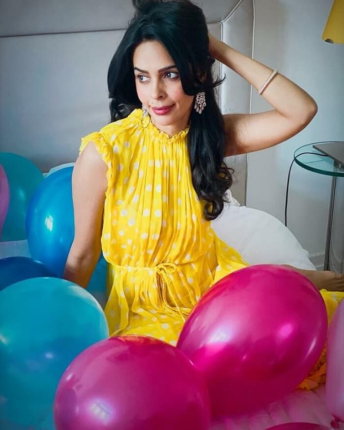 Mallika Sherawat In Yellow Dress