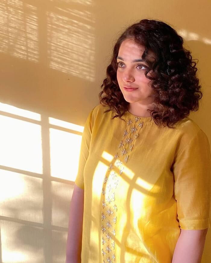 Nithya Menon Smiling Stills In Yellow Churidar