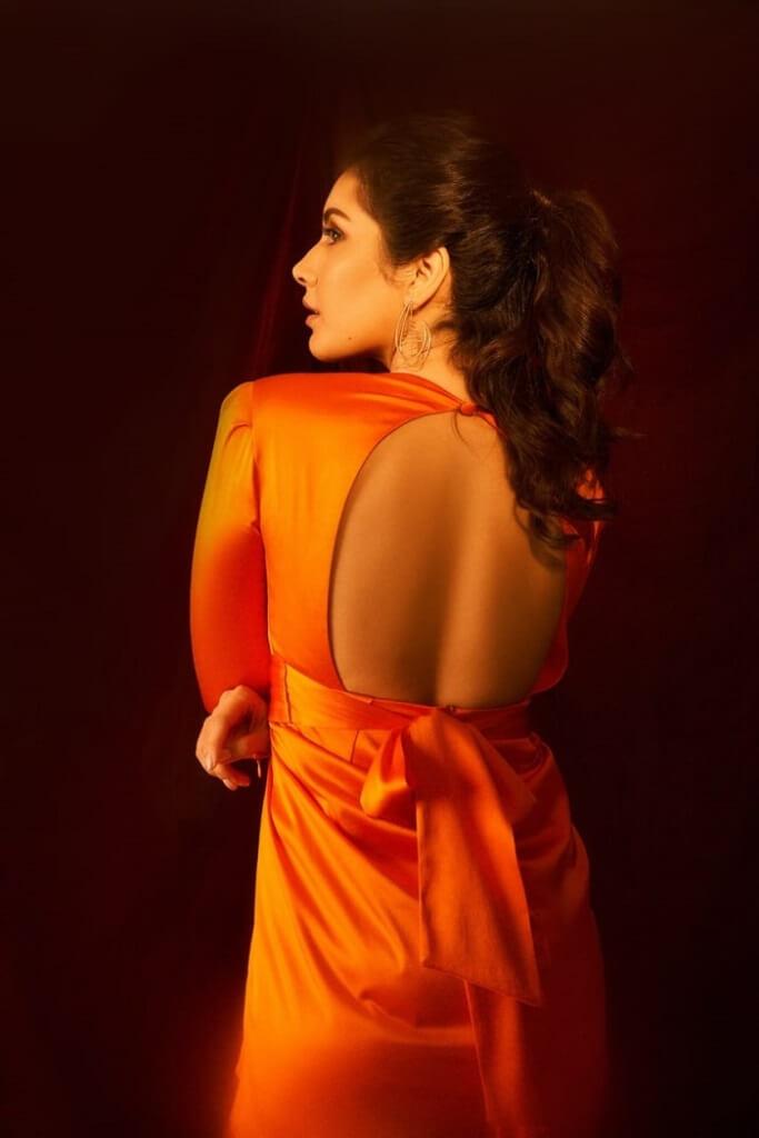 Rashi Khanna Sizzling Pics In Orange Skirt a